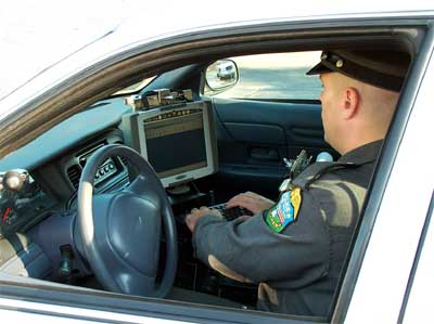 Smithfield Police Officer using a mobile data terminal (MDT)