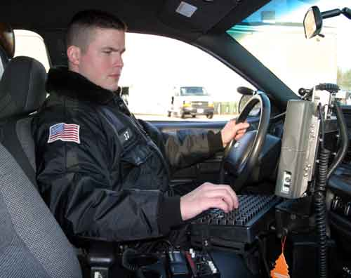 Officer Jeff Scott demonstrates the mobile data terminal (MDT) setup.