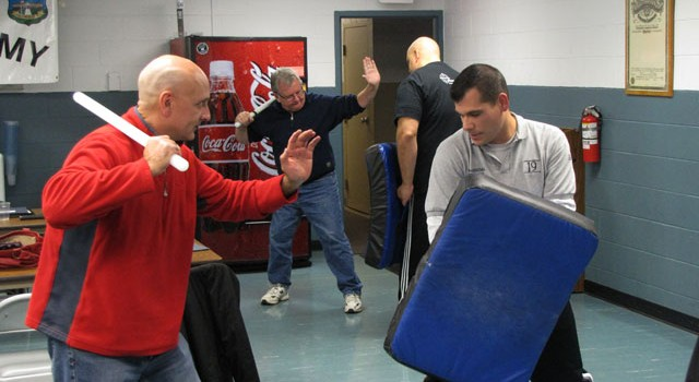 Sgt. Gerald Pezzullo (R) demonstrates baton training at the Smithfield PD Ctizens' Police Academy.